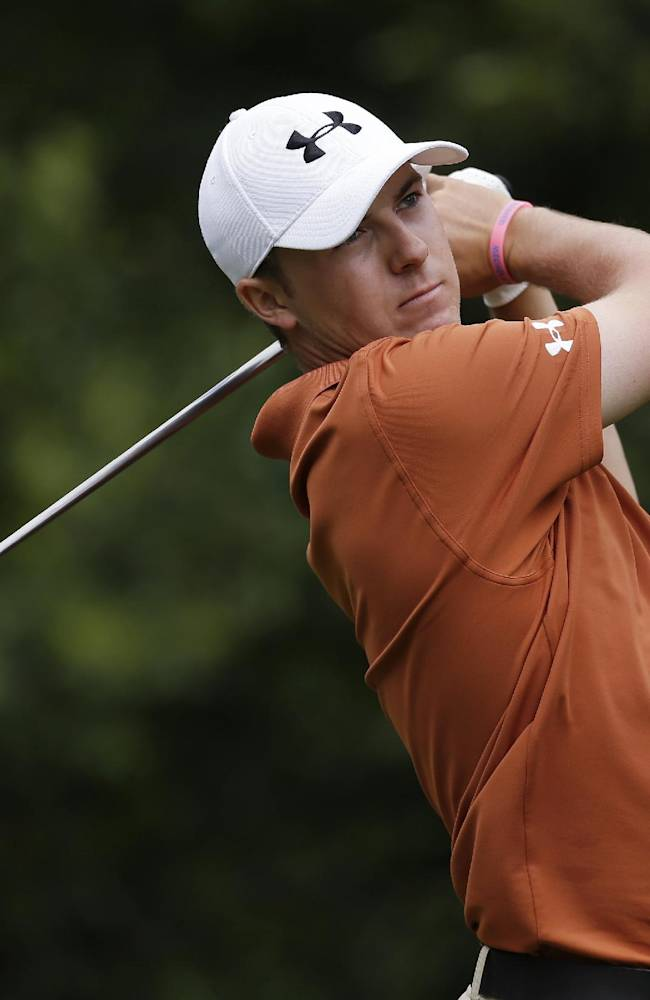 In this March 17, 2013, file photo, Jordan Spieth tees off on the 11th hole during the final round of the Tampa Bay Championship golf tournament in Palm Harbor, Fla.