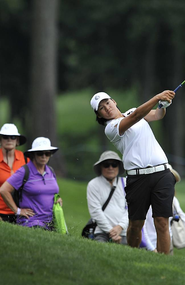 Yani Tseng, of Taiwan, follows through from the rough on the seventh hole during the first round of the International Crown golf tournament Thursday, July 24, 2014, in Owings Mills, Md