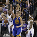 Golden State Warriors forward David Lee, center, flashes one finger after scoring between Sacramento Kings' Jason Thompson, left, and Isaiah Thomas during the fourth quarter of an NBA basketball game in Sacramento, Calif., Wednesday, Feb. 19, 2014. The Wa