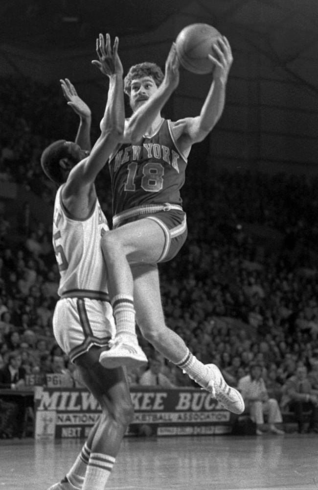 In this Dec. 29, 1974 file photo, New York Knicks' Phil Jackson (18) goes to the basket against Milwaukee Bucks' Cornell Warner during an NBA basketball game in Milwaukee. Carmelo Anthony says he has heard that 11-time NBA champion coach Phil Jackson will be