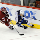 Arizona Coyotes right wing Shane Doan (19) and Winnipeg Jets defenseman Paul Postma (4) race for the puck in the third period during an NHL hockey game, Thursday, Jan. 8, 2015, in Glendale, Ariz. Arizona won 4-1 The Associated Press