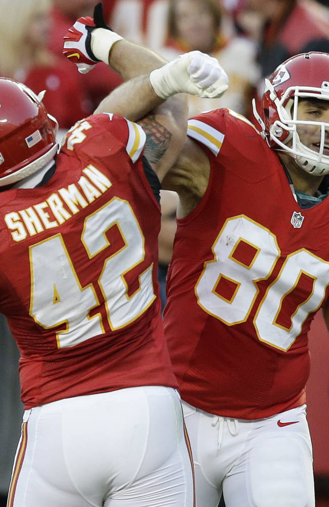 Kansas City Chiefs tight end Anthony Fasano (80) celebrates a touchdown with fullback Anthony Sherman (42) during the first half of an NFL football game, Sunday, Dec. 1, 2013, in Kansas City, Mo