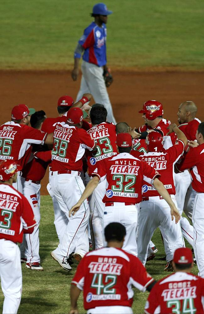 Mexico player celebrate after defeating the Dominican Republic 3-2 in their Caribbean Series baseball semifinal game in Porlamar, Venezuela, Thursday, Feb. 6, 2014. Mexico advances to the final