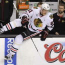 Chicago Blackhawks right wing Marian Hossa (81), of Slovakia, takes the ice for warm-ups before Game 4 of the NHL hockey Stanley Cup Finals against the Boston Bruins, Wednesday, June 19, 2013, in Boston. (AP Photo/Charles Krupa)