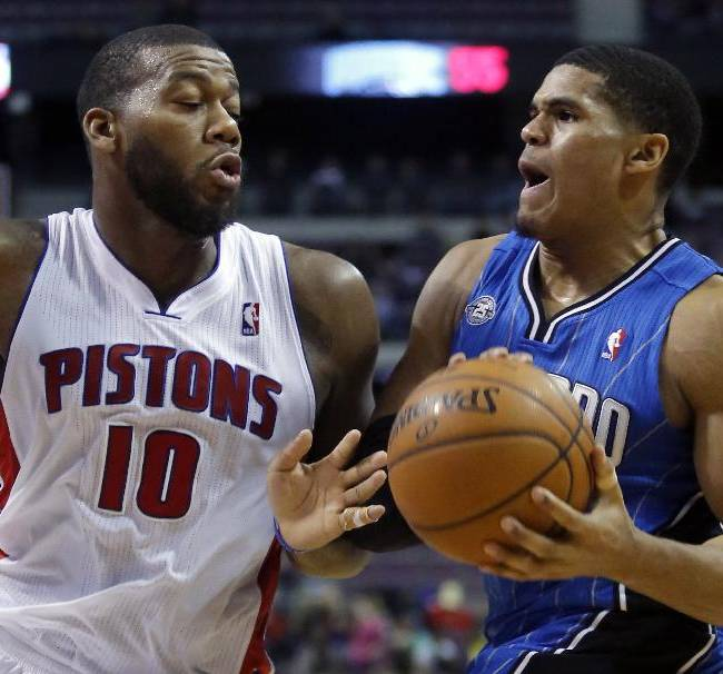 Orlando Magic forward Tobias Harris drives against Detroit Pistons center Greg Monroe (10) during the second half of an NBA basketball game Tuesday, Jan. 28, 2014, in Auburn Hills, Mich. The Pistons won 103-87
