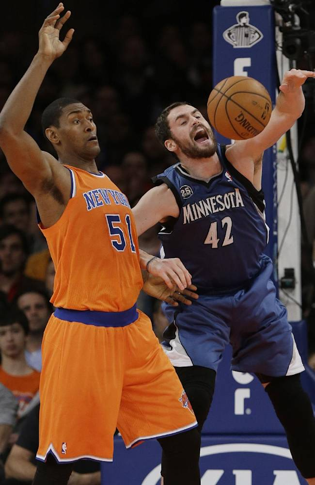 Minnesota Timberwolves' Kevin Love (42) fights for control of the ball with New York Knicks' Metta World Peace (51) during the first half of an NBA basketball game Sunday, Nov. 3, 2013, in New York
