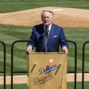 Los Angeles Dodgers announcer Vin Scully leads an eulogy for late Dr. Frank Jobe during a memorial service at Dodger Stadium in Los Angeles Monday, Apr. 7, 2014. Dr. Frank Jobe, was the surgeon who pioneered the elbow procedure that became known as Tommy John surgery and saved the careers of countless pitchers. Jobe died last month at 88. (AP Photo/Damian Dovarganes)