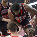Chicago Bulls' Nazr Mohammed, top, confronts Toronto Raptors' Tyler Hansbrough after a loose ball foul during the first half of an NBA basketball game, Wednesday, Feb. 19, 2014 in Toronto The Associated Press