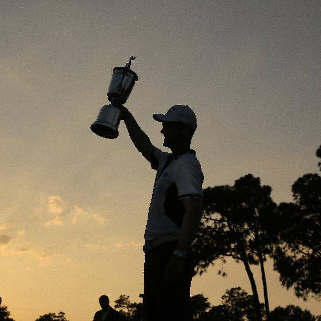 Martin Kaymer, of Germany, poses with trophy after wining the U.S. Open golf tournament in Pinehurst, N.C., Sunday, June 15, 2014