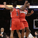 Washington Wizards' Martell Webster (9) and Bradley Beal (3) celebrates after the second half of an NBA basketball game Friday, April 4, 2014, in New York. The Wizards won the game 89-90 The Associated Press