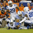 Indianapolis Colts inside linebacker Jerrell Freeman, bottom chases a lose ball he stripped away from Denver Broncos tight end Julius Thomas (80) as teammates Darius Butler (20), Mike Adams (29) and LaRon Landry (30) pursue during the second half of an NF