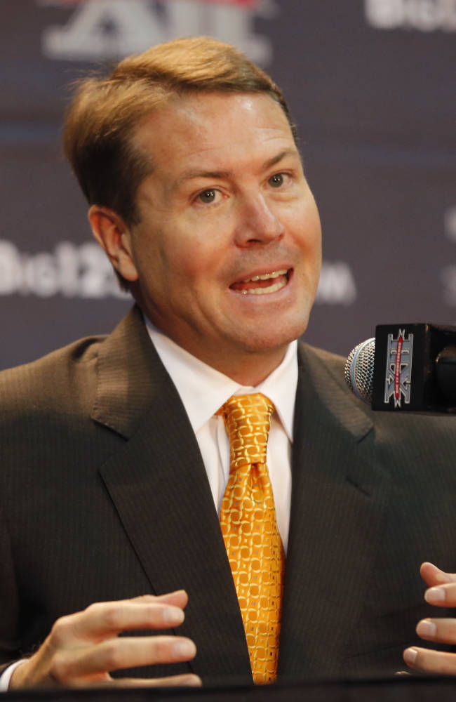 Oklahoma State coach Travis Ford answers questions at a news conference during Big 12 NCAA college basketball media day in Kansas City, Mo., Tuesday, Oct. 22, 2013
