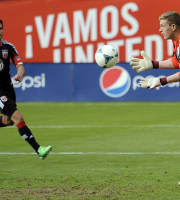 Philadelphia Union goalkeeper Zac MacMath (18) prepares the catch the ball as D.C. United midfielder Chris Pontius, left, converges during the second half of an MLS soccer game on Sunday, April 21, 2013, in Washington. The Union won 3-2. (AP Photo/Nick Wass)