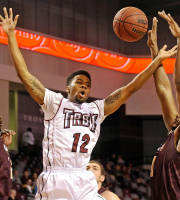Troy guard JC Bonny, center, loses control of the ball on the defense of Louisiana-Monroe forward Tylor Ongwae, left, and forward Jayon James (1) during the first half of an NCAA college basketball game in Troy, Ala., Thursday, Jan. 16, 2014. (AP Photo/The (Troy)