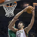 Milwaukee Bucks' Zaza Pachulia shoots over Boston Celtics' Kris Humphries during the second half of an NBA basketball game Saturday, Nov. 30, 2013, in Milwaukee The Associated Press