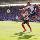 West Bromwich Albion's Chris Brunt clears as Southampton's Ryan Bertrand, rear, closes in during the English Premier League match at St Mary's, Southampton, England, Saturday Aug. 23, 2014