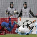 CSKA's Seydou Doumbia, left, tumbles after scoring his side's first goal during the Champions League Group E soccer match between CSKA Moscow and Manchester City at Arena Khimki stadium in Moscow, Russia, Tuesday Oct. 21, 2014