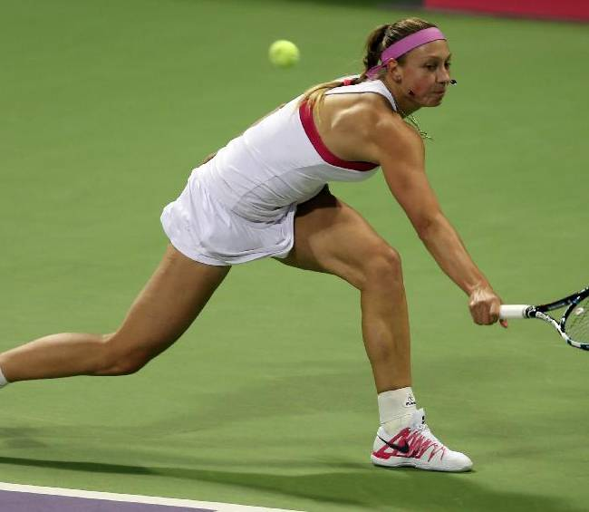 Yanina Wickmayer of Belgium returns the ball to Caroline Wozniacki of Denmark during the third day of the WTA Qatar Ladies Open in Doha, Qatar,Wednesday, Feb. 12, 2014