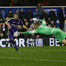 Manchester City's Sergio Aguero scores a goal past QPR's goalkeeper Robert Green during the English Premier League soccer match between Queens Park Rangers and Manchester City at Loftus Road stadium in London, Saturday, Nov. 8, 2014