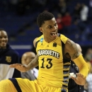 Marquette guard Vander Blue (13) reacts in the second half of a third-round NCAA college basketball tournament game against Butler Saturday, March 23, 2013, in Lexington, Ky. Marquette won 74-72. (AP Photo/James Crisp)