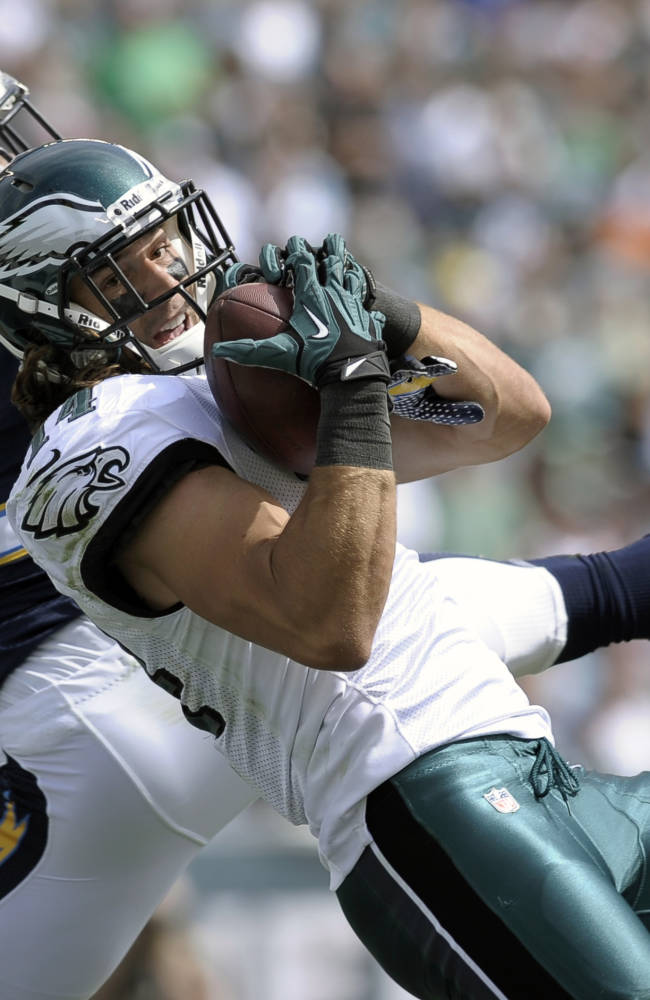 Philadelphia Eagles' Riley Cooper, right, pulls in a touchdown pass as San Diego Chargers' Derek Cox defends during the first half of an NFL football game on Sunday, Sept. 15, 2013, in Philadelphia