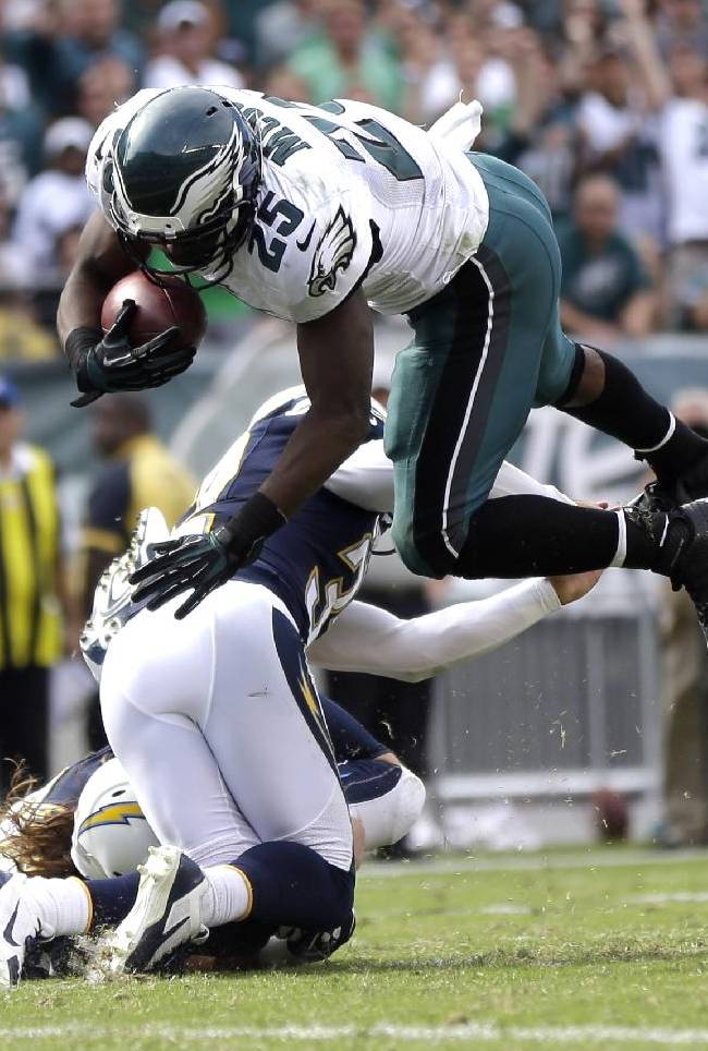 Philadelphia Eagles' LeSean McCoy, right, is tackled by San Diego Chargers' Eric Weddle during the second half of an NFL football game, Sunday, Sept. 15, 2013, in Philadelphia