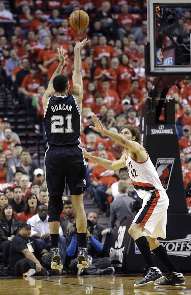 Portland Trail Blazers' Robin Lopez (42) defends against San Antonio Spurs' Tim Duncan (21) in the first quarter of Game 3 of a Western Conference semifinal NBA basketball playoff series Saturday, May 10, 2014, in Portland, Ore