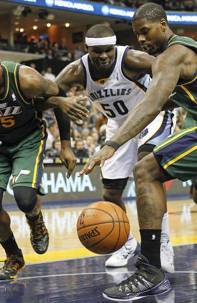 Memphis Grizzlies forward Zach Randolph (50) fights for a rebound against Utah Jazz forwards Derrick Favors (15) and Marvin Williams (2) in the first half of an NBA basketball game on Wednesday, March 19, 2014, in Memphis, Tenn