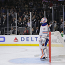 Edmonton Oilers goalie Ben Scrivens looks at the scoreboard after a goal by Los Angeles Kings' Tanner Pearson during the second period of an NHL hockey game Tuesday, Oct. 14, 2014, in Los Angeles The Associated Press