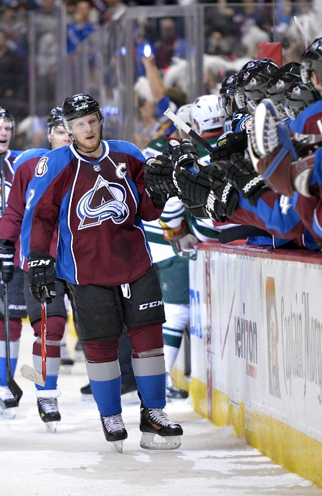 Colorado Avalanche left wing Gabriel Landeskog (92), from Sweden, celebrates his goal against the Minnesota Wild with members of the bench during the first period in Game 1 of an NHL hockey first-round playoff series on Thursday, April 17, 2014, in Denver