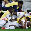 The Cuba team piles onto Jeniel Molina (bottom R) after he scored against Belize during their CONCACAF Gold Cup soccer match in Hartford, Connecticut, July 16, 2013. REUTERS/Dominick Reuter