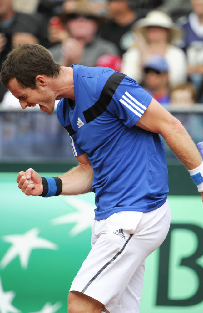 Britain's Andy Murray celebrates after winning his a match against United States' Sam Querrey at the Davis Cup tennis matches on Sunday, Feb. 2, 2014, in San Diego