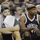 Brooklyn Nets' Deron Williams, left, and Jason Terry watch the action from bench action during the fourth quarter of their 107-86 loss to the Sacramento Kings in a NBA basketball game in Sacramento, Calif., Wednesday, Nov. 13, 2013 The Associated Press