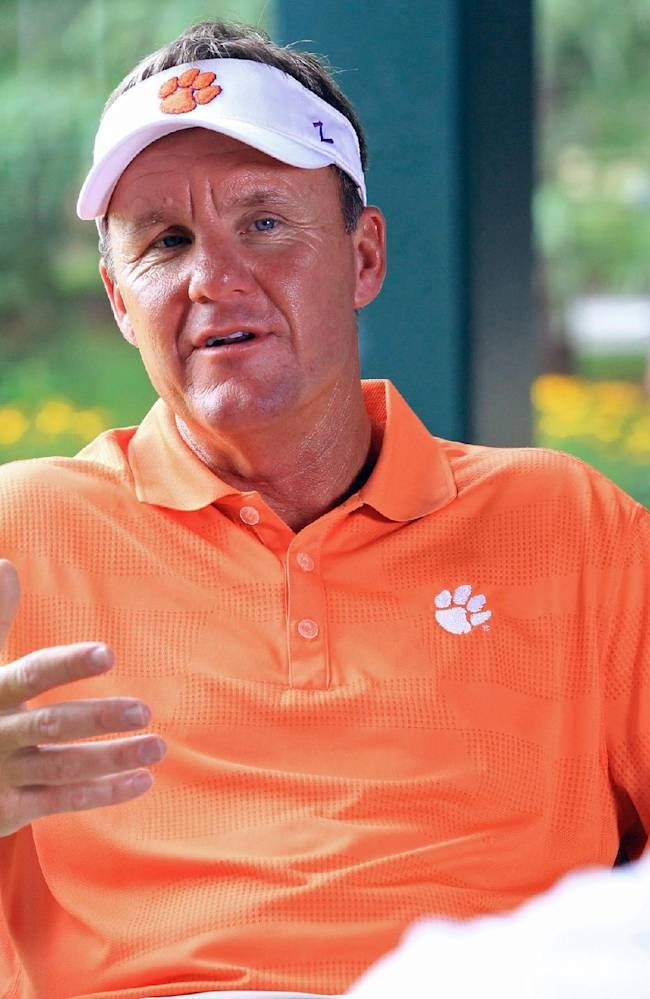 Clemson NCAA college football offensive coordinator Chad Morris answers a question at head coach Dabo Swinney's annual media golf outing at The Reserve at Lake Keowee in Sunset, S.C. on Tuesday, July 15, 2014