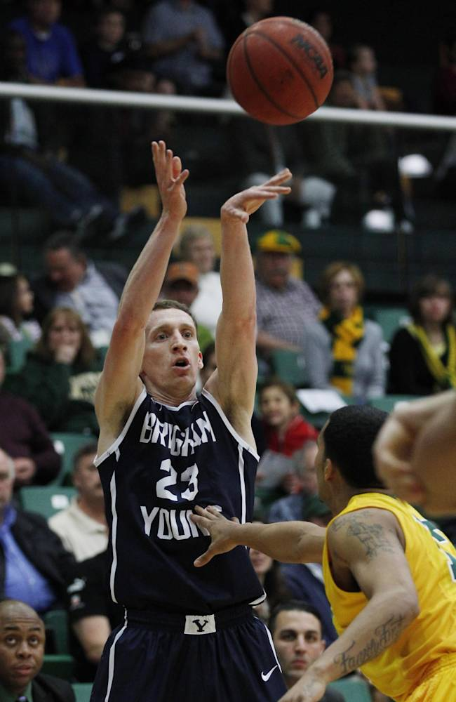 BYU's Skylar Halford (23) shoots over San Francisco's Avry Holmes during the first half of an NCAA college basketball game, Thursday, Jan. 16, 2014 in San Francisco