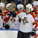 Florida Panthers defenseman Erik Gudbranson (44) celebrates with teammates after scoring against the Tampa Bay Lightning during the second period of an NHL hockey game Thursday, Oct. 9, 2014, in Tampa, Fla The Associated Press