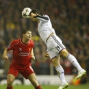 Basel's Behrang Safari, right, heads the ball clear from Liverpool's Steven Gerrard during the Champions League Group B soccer match between Liverpool and FC Basel at Anfield Stadium in Liverpool, England, Tuesday, Dec. 9, 2014