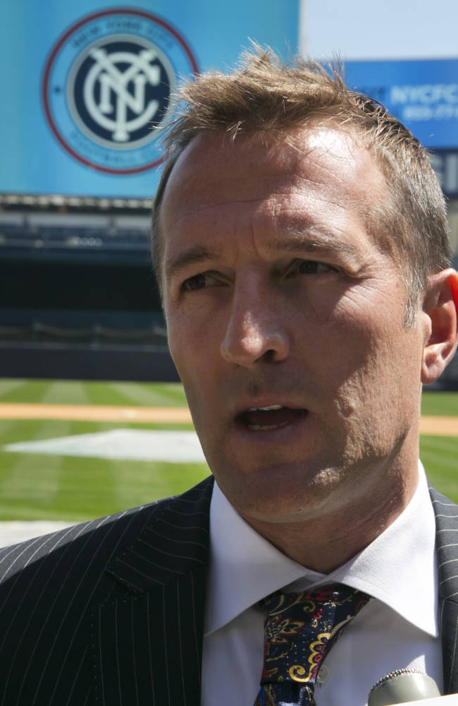 New York City Football Club soccer head coach Jason Kreis, answers questions on the field at New York's Yankee Stadium,  Monday, April 21, 2014.  The Yankees announced that Yankee Stadium will serve as the Club's first home and begin play on March 2015