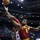 Cleveland Cavaliers forward Earl Clark (6) is fouled by Detroit Pistons center Andre Drummond (0) while laying up the ball during the first half of an NBA basketball game Wednesday, Feb. 12, 2014, in Auburn Hills, Mich The Associated Press