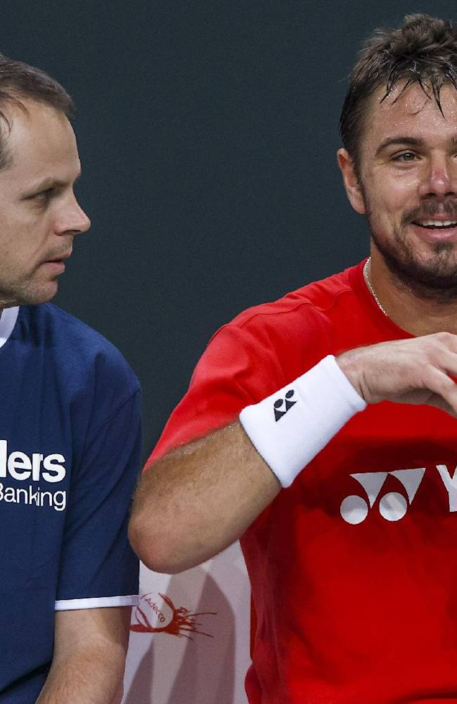 Swiss Davis Cup Team captain Severin Luethi, left, speaks to  tennis player Stanislas Wawrinka, right, of Switzerland, during a training session of the Swiss  Davis Cup Team prior to the Davis Cup World Group quarterfinal between Switzerland and Kazakhstan,   in Geneva, Switzerland, Tuesday, April 1, 2014