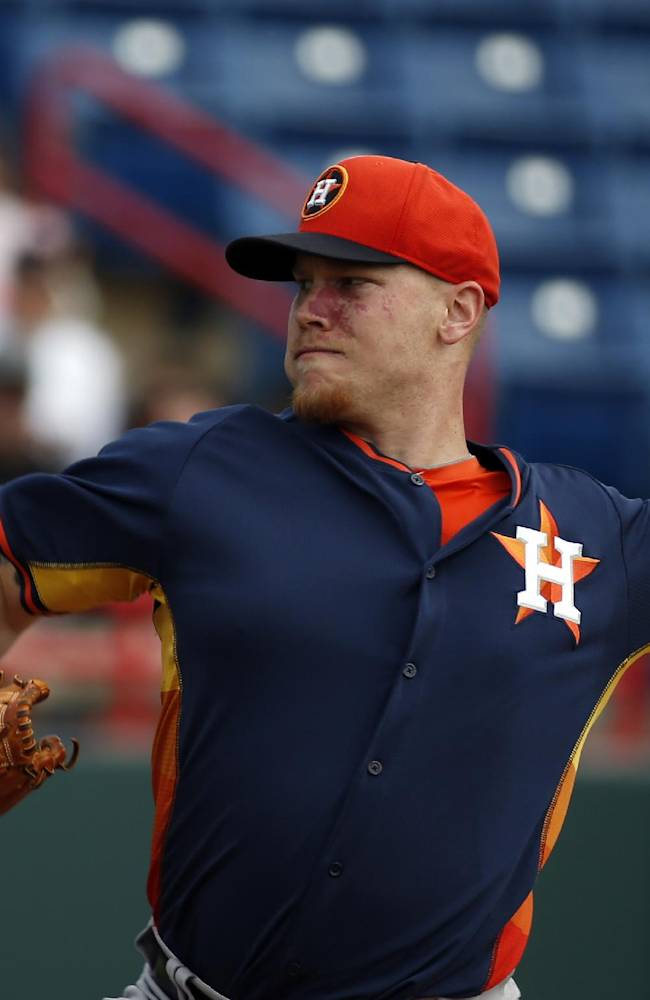 Houston Astros starting pitcher Brett Oberholtzer throws in the first inning of a spring exhibition baseball game against the Washington Nationals, Friday, March 7, 2014, in Viera, Fla