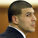 Former New England Patriots football player Aaron Hernandez listens during his murder trial, Thursday, Jan. 29, 2015, in Fall River, Mass. Hernandez is charged with killing semiprofessional football player Odin Lloyd, 27, in June 2013 The Associated Press