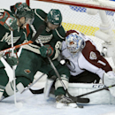 Colorado Avalanche goalie Semyon Varlamov (1), of Russia, covers the net as Minnesota Wild center Mikael Granlund, center, of Finland, and Wild left wing Matt Cooke, left, try to get at the puck during the first period of Game 3 of an NHL hockey first-ro