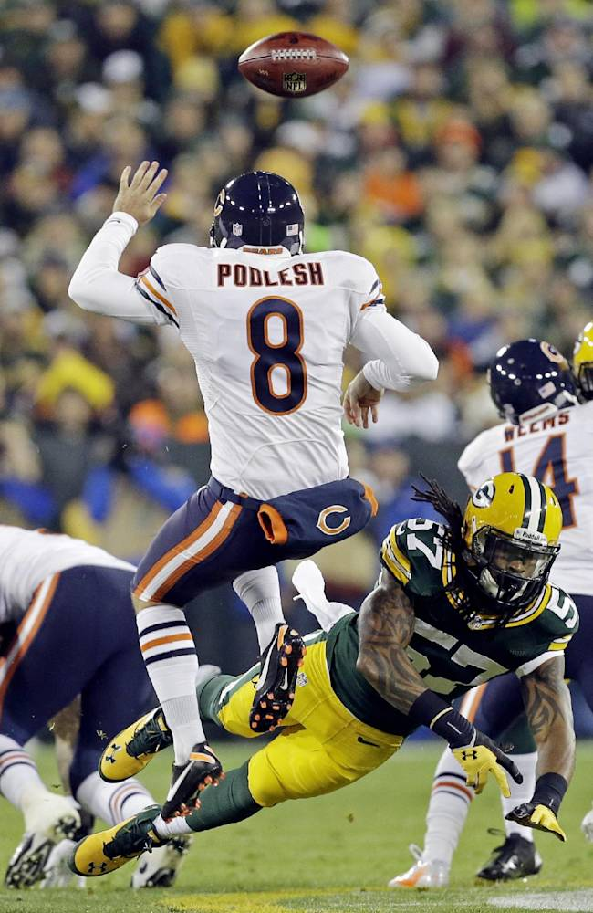 Green Bay Packers' Jamari Lattimore (57) blocks the punt of Chicago Bears' Adam Podlesh (8) during the first half of an NFL football game Monday, Nov. 4, 2013, in Green Bay, Wis