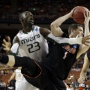 Pacific's Trevin Harris (1) grabs a rebound in front of Miami's Tonye Jekiri (23) nduring the first half of a second-round game of the NCAA college basketball tournament Friday, March 22, 2013, in Austin, Texas.  (AP Photo/David J. Phillip)
