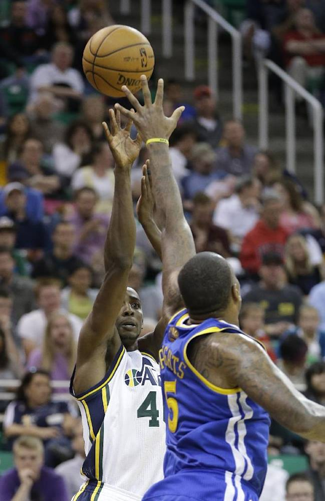 Utah Jazz's Jeremy Evans, left, shoots as Golden State Warriors' Marreese Speights (5) defends in the second half during an NBA preseason basketball game Tuesday, Oct. 8, 2013, in Salt Lake City. The Jazz won 101-78