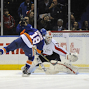 Washington Capitals goalie Braden Holtby (70) blocks a shot on goal by New York Islanders' Ryan Strome (18) during the shootout in an NHL hockey game Saturday, April 5, 2014, in Uniondale, N.Y. The Capitals won 4-3 The Associated Press