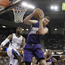 Phoenix Suns center Miles Plumlee, center, grabs a rebound against Sacramento Kings forward Jason Thompson, left, during the third quarter of an NBA basketball game in Sacramento, Calif., Wednesday, April 16, 2014. The Suns won 104-99 The Associated Pr