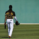 Pittsburgh Pirates center fielder Andrew McCutchen walks across a practice field on the way to a bunting drill during the team's baseball spring training workout in Bradenton, Fla., Thursday, Feb. 20, 2014 The Associated Press