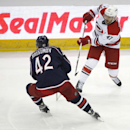 Carolina Hurricanes' Michael Jordan (47) passes around Columbus Blue Jackets' Artem Anisimov (42) during the third period of a preseason NHL hockey game, Wednesday, Oct. 1, 2014, in Columbus, Ohio The Associated Press